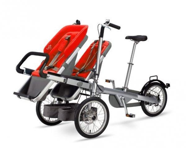 portare due bambini in bici seggiolino rossa